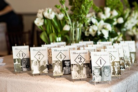 table numbers with black and white photos of bride and groom when they were that particular age
