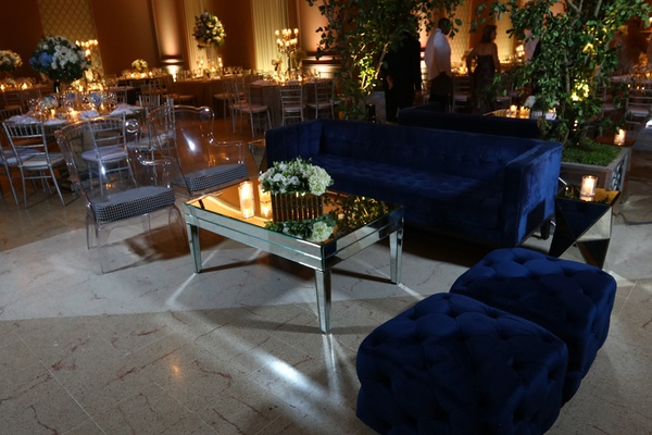 dimly lit lounge space navy couch reflective dominican republic wedding ballroom hotel reception