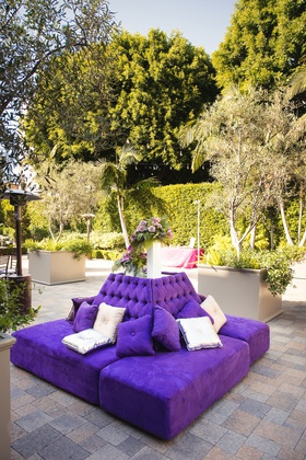 Outdoor wedding cocktail hour vibiana purple settee bench lounge furniture silver pillows