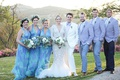 bridesmaids in turquoise and lavender infinity dresses, groomsmen in lavender suit jackets