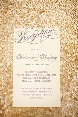 Gold sequin background with blue and white reception card