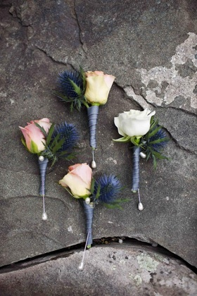 White and pink roses and blue thistles for groom