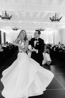 black and white photo of bride in romona keveza dancing with groom