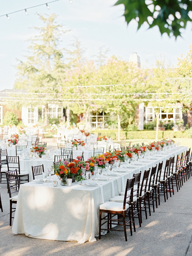 Long wedding table at private residence of bride's parents and long farm table decorations