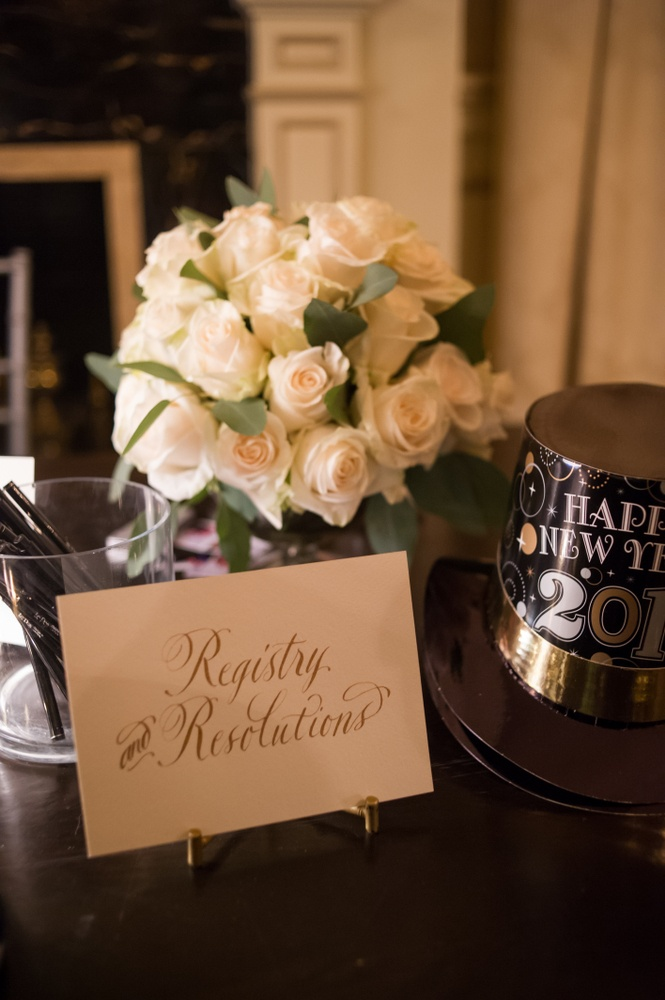 Registry and Resolutions NYE table at wedding