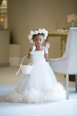 flower girl with feathered hem, floral crown of roses, white gloves