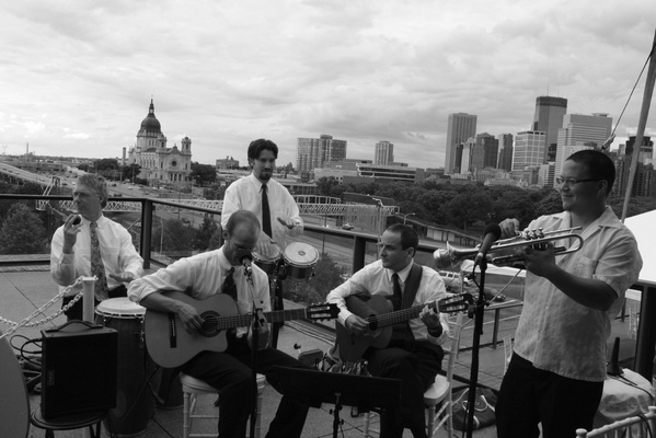 Black and white picture of five piece band on rooftop