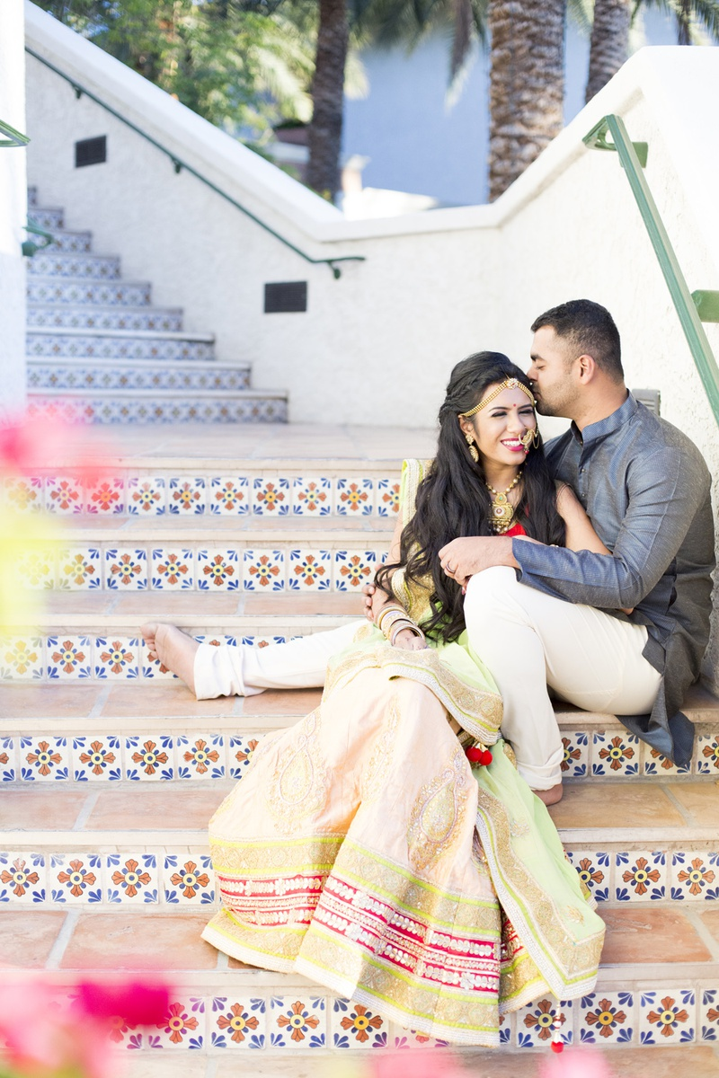 south asian wedding inspiration, bride in lehenga, bride and groom on tiled stairs