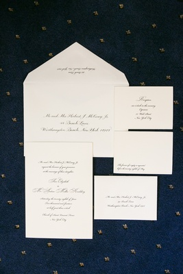 Simple script font wedding invitations on blue background