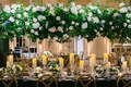 wedding reception long table gold chairs candles tall centerpiece white rose hydrangea blue flowers