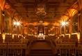 New York City hotel ballroom with golden lighting