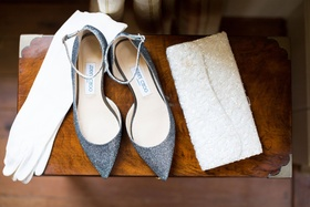 White gloves, sparkly Jimmy Choo pointy toe pumps, and white clutch with beads