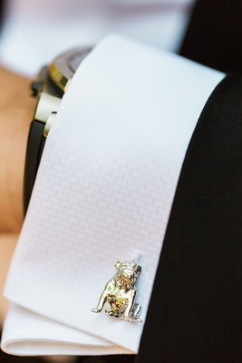 Groom cufflinks in shape design of dog who had to be left at home pet in wedding ideas