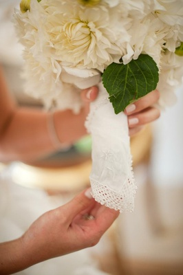 White hanky around wedding bouquet stems