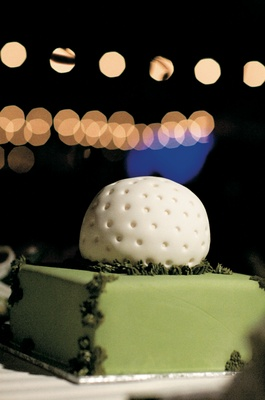 Groom cake in shape of golf ball on green lawn