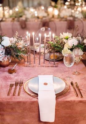 flat acrylic candle holder with skinny tapered candles at reception table