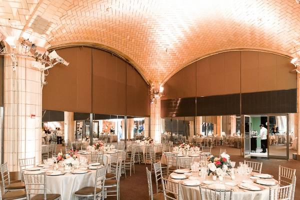 Wedding reception tall arches new york city round tables silver chairs low centerpieces
