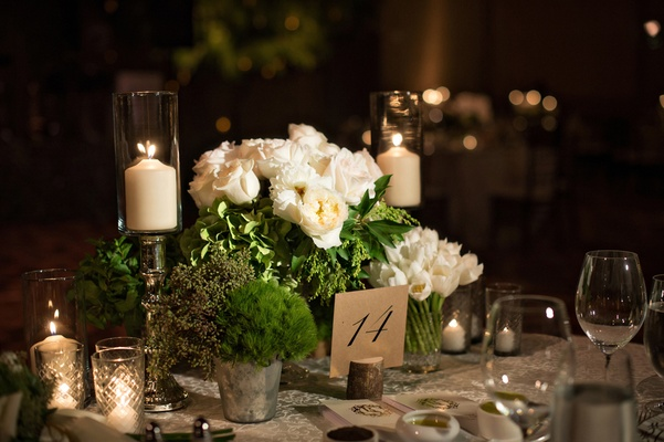 white rose, white tulip centerpieces, greenery in metal pails