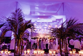 beach wedding reception dance floor purple lights candles palm trees tent wedding venue