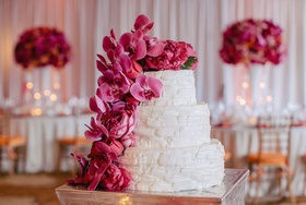 Basket-style frosting with fuchsia peonies and orchids