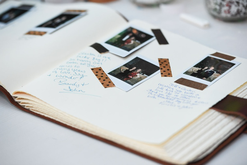 wedding guest book ideas polaroid photos with washi tape and guest comments leather bookmark