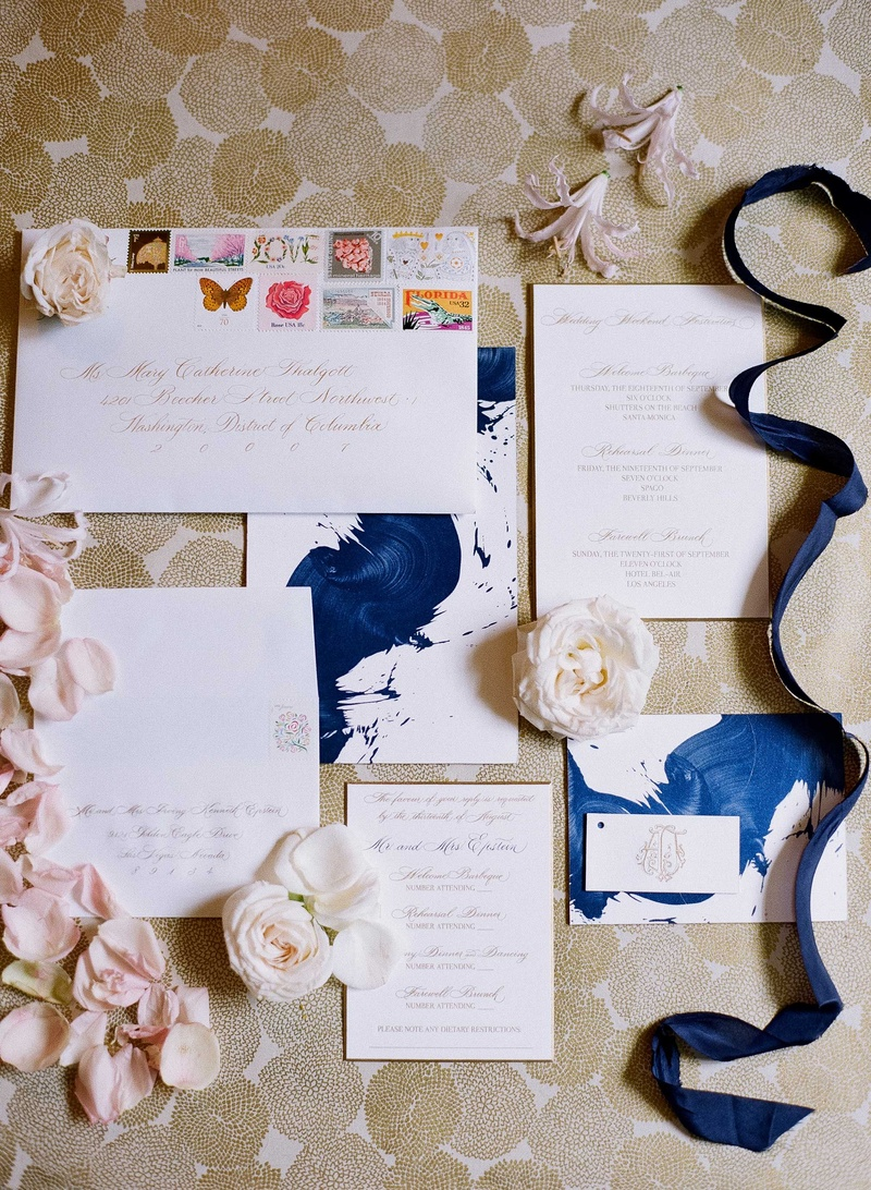 Storkie Express wedding invitation suite with blue paint brush stroke design and stamps