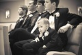 Black and white photo of young bored ring bearer