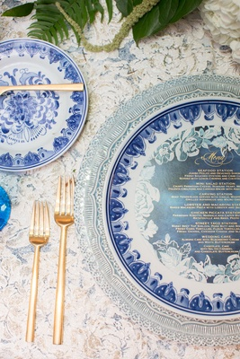 Wedding reception linen gold forks blue white china with blue menu card flower design gold writing
