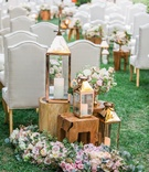 Hotel Bel-Air wedding ceremony green lawn flowers on floor wood tables gold lanterns and vase flower