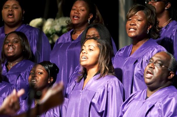 Gospel choir in purple robes perform at wedding ceremony