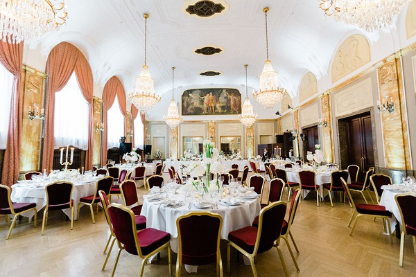 destination second wedding in germany burgundy gold guest chairs white centerpiece gold chandeliers