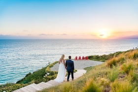 malibu wedding, bride and groom walking to enjoy the sunset, wedding picture sunset over ocean