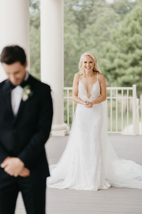 former miss america savvy shields approaching groom during first look berta wedding dress