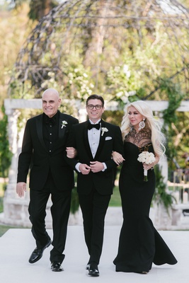 matthew lawrence wedding black tuxedo white shirt with father in black shirt and mother in gown