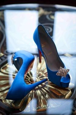 Bride's royal blue Louboutin peep-toe heels with rhinestone accents