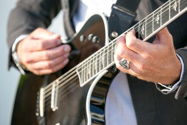 Man playing electric guitar at vow renewal wedding entertainment ideas david aldo