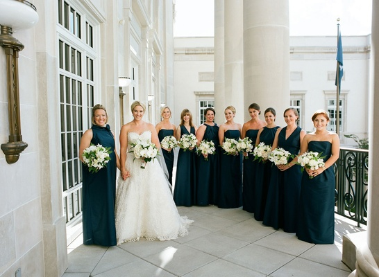 Bride in oscar de la renta gown with maid of honor and bridesmaids differing necklines