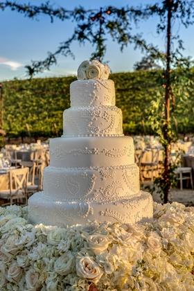 Five layer wedding cake at vineyard wedding
