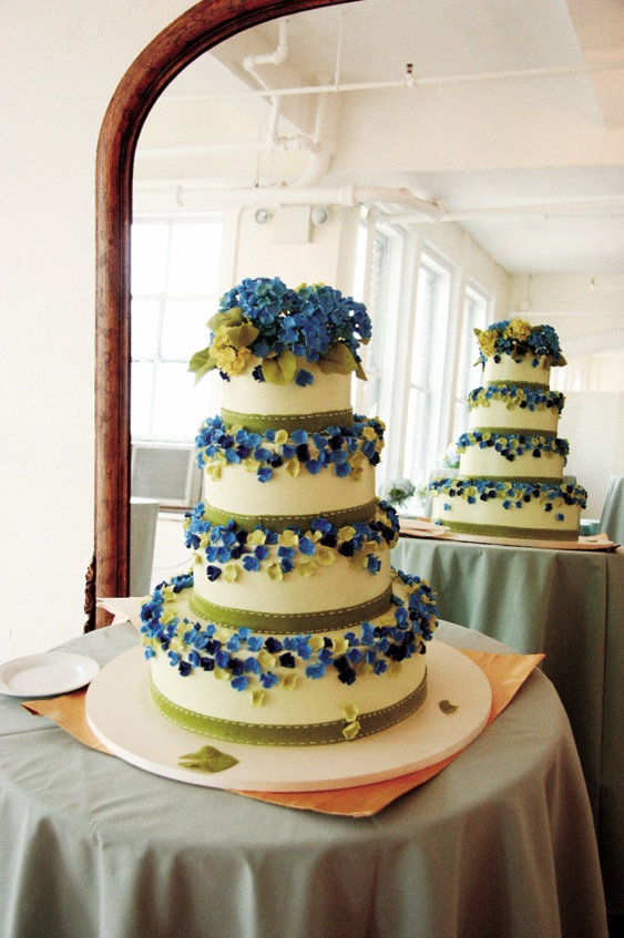 Four layer cake with royal blue and celadon decorations
