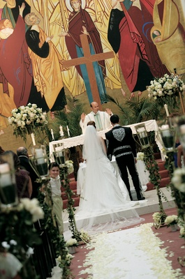 Couple married in colorful church with rose petals