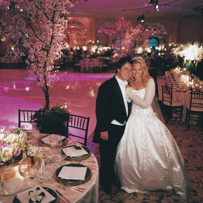 Groom in long tail tux and bride in princess ball gown