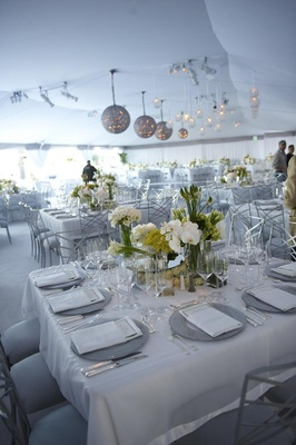 Tent wedding reception with white decorations