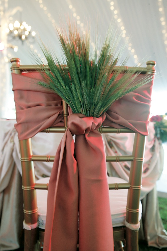 Gold chair tied with red sash and dried green barley and wheat