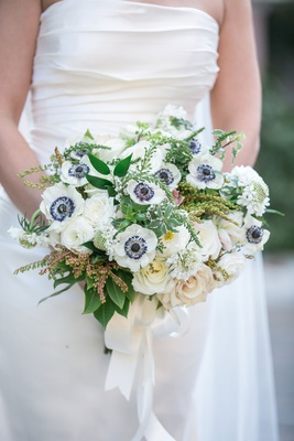 wedding bouquet white rose and white anemone with dark center green leaves