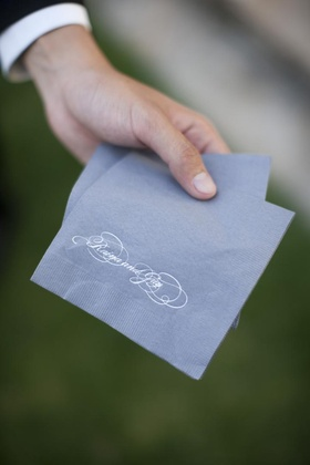 Blue napkin with white calligraphy lettering