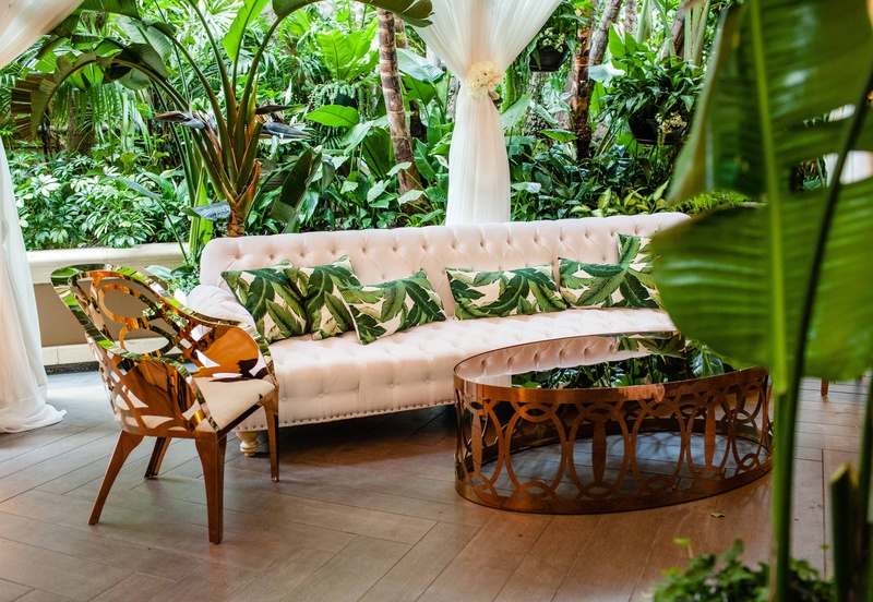 Tropical Leaf Print Throw Pillows On Tufted Sofa Rose Gold Coffee Table  Armchair At Wedding Lounge