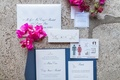 Invitation with blue exterior, pink hummingbird details, save-the-date
