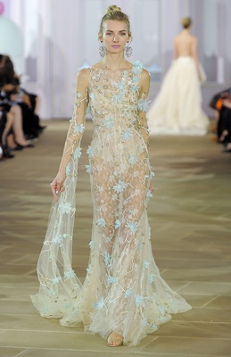 Tulle and Chantilly lace sheath with illusion boat neck and dramatic sleeve with aqua flowers and br