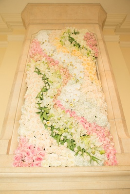 Wedding reception with a frame of pink, white, peach roses, tulips, orchids, hydrangeas, lilies