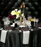 new year's eve wedding, black and white linens, plum calla lilies, white amaryllis, black candles